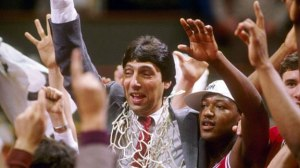 Jim Valvano cut the nets down for real in 1983. Dereck Whittenburg (right) is now on the NC State coaching staff.