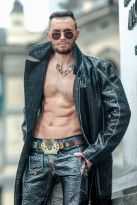 Scary yet fit biker guy with way cool long leather coat. And check out that belt buckle!