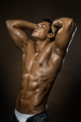Shirtless tan guy